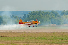 Yak-52 plane from Pervyj Polyot team lands. ZHUKOVSKY, RUSSIA - AUGUST 12: Yak-52 plane from Pervyj Polyot display team lands during the celebration of the Stock Photos