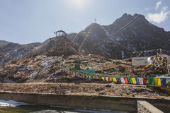 Yak riding mountain spot with Tibetan prayer flags with sunlight and clear sky in winter in Tashi Delek near Gangtok. North Sikkim Stock Photo