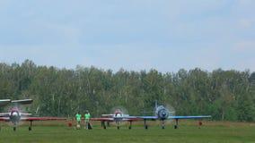 YAK-52 sport planes preparing for take-off. NOVOSIBIRSK, RUSSIAN FEDERATION - JULY 26, 2015: YAK-52 sport planes preparing for take-off. Airshow 'Wings of stock video