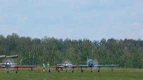 YAK-52 sport planes preparing for take-off. NOVOSIBIRSK, RUSSIAN FEDERATION - JULY 26, 2015: YAK-52 sport planes preparing for take-off. Airshow 'Wings of stock footage