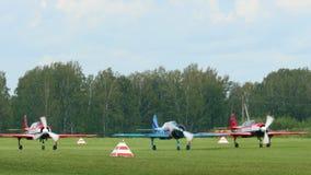 YAK-52 sport planes preparing for take-off. NOVOSIBIRSK, RUSSIAN FEDERATION - JULY 26, 2015: YAK-52 sport planes preparing for take-off. Airshow -Wings of stock video footage