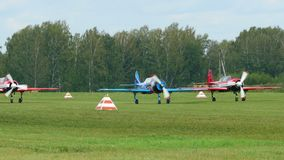 YAK-52 sport planes preparing for take-off. NOVOSIBIRSK, RUSSIAN FEDERATION - JULY 26, 2015: YAK-52 sport planes preparing for take-off. Airshow -Wings of stock video