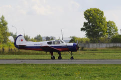 The Yak-18t plane on a runway. Royalty Free Stock Photography