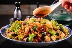 Yakisoba. Chinese noodles on black background Royalty Free Stock Photography
