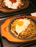 Yakisoba with Fried Egg on Top. Yakisoba on Hot Plate with Fried Egg on Top Royalty Free Stock Image