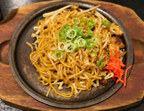 Yakisoba on Hot Plate. With Onion and Carrot Royalty Free Stock Images