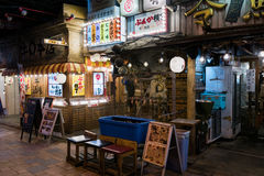 Yakitori Alley. Tokyo, Japan - January 21, 2016: Japanese restaurants at the Yakitori Alley in Yurakucho Under the JR Yamanote Tracks Stock Photo
