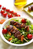 Yakitori with chicken liver, dried apricots, tomatoes and green Stock Images