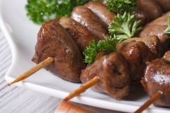 Yakitori grilled chicken hearts on skewers close-up, horizontal Stock Photography