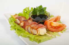 Yakitori with the heart and bacon. Japanese yakitori with the heart and bacon on a white plate Stock Image