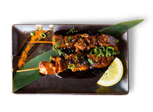 Yakitori isolated. Japanise style grilled chicken yakitori beautifully served on the plate isolated Royalty Free Stock Photo