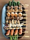 Yakitori: Japanese grilled bite-sized food on skewers. A platter of Yakitori: Japanese grilled bite-sized food on skewers Stock Image