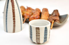 Yakitori and sake cup Stock Photography