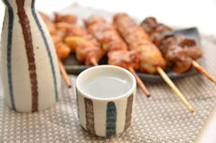Yakitori and sake cup Stock Photos
