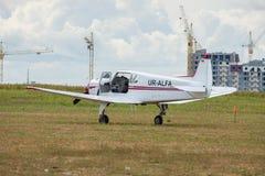 Yakovlev Yak-18T. Kiev, Ukraine - August 29, 2010: Yakovlev Yak-18T light plane parked on the grass airfield Stock Photos
