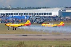 Yakovlev Yak-52. ZHUKOVSKY, MOSCOW REGION, RUSSIA - AUG 29, 2015: Landing on the airfield Ramenskoe aerobatic team First flight on Yakovlev Yak-52 plane at the Stock Images