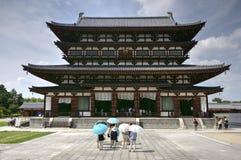 Yakushi-ji temple, Nara, Japan. Buddhist temple Yakushi-ji with tourist in foreground in Nara, Japan Stock Photo