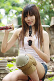 Yakuza girl. Thai sexy girl holding the pistol and sword Stock Image