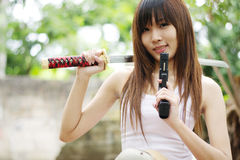 Yakuza girl. Thai sexy girl holding the pistol and sword Royalty Free Stock Images
