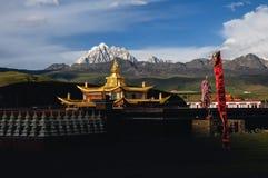 Yala snowberg and Muya golden stupa Stock Images