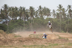 Yala, Thailand - APRIL 20, 2014: Motorcross riders jump in Yala. Motorcross Competition 2014. at Muangmai Track in Yala, Thailand Stock Photography