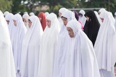 YALA, THAILAND - AUGUST 8 : Thai Musim female dress in hijab and. Pray for Allah Islamic God in Hari Raya Day Idil Fitri 1434 H. on Aug 8, 2013 at Yala Youth stock photography