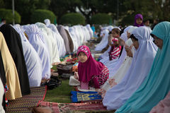 YALA, THAILAND - AUGUST 8 : Thai Musim girl come with family to. Pray for Allah Islamic God in Hari Raya Day Idil Fitri 1434 H. on Aug 8, 2013 at Yala Youth royalty free stock images