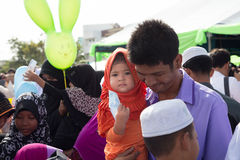 YALA, THAILAND - AUGUST 8 : Thai Muslim female child get money f. Rom adults in Hari Raya Day Idil Fitri 1434 H. on Aug 8, 2013 at Yala Youth Center, Thailand royalty free stock images
