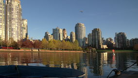 Yaletown Dock, Seawall Morning, Vancouver 4K. The view from a dock in False Creek of Yaletown condominiums in downtown Vancouver. British Columbia, Canada. Dolly stock footage