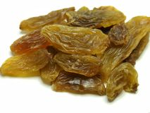 Yallow dry raisins isolated on white background stock photography