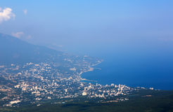 Yalta city from Mount Ai-Petri. Aerial view of Yalta city from Mount Ai-Petri mountain in Crimea royalty free stock photography