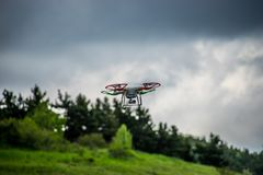Natural landscape with green grass field under the sky with clouds and quadcopter. Yalta, Crimea-June 1, 2016: Natural landscape with green grass field under Stock Photos