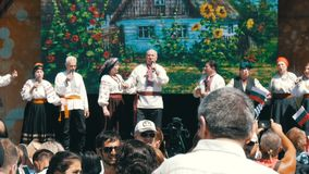 Yalta, Crimea - May 1, 2018: Concert of the Ukrainian ethnic group from the stage. Yalta, Crimea - May 1, 2018: A cheerful Concert of the Ukrainian ethnic group stock video footage