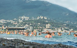 Yalta, Crimea, Seaside beach. People bathe in the sea. On the background view of the city and mountains Royalty Free Stock Images