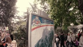 YALTA CRIMEA UKRAINE RUSSIA - MAY 1. Festive demonstration march on the Day of stock video footage