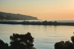 Yalta harbor in a warm light of sunrise Stock Photo