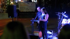 Street rock band plays guitars, drums and sing songs at night stock video