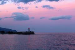 Yaltavuurtoren bij zonsondergang Stock Afbeelding