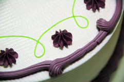 Yam Cake. A yam birthday cake decorated with white and purple cream royalty free stock images