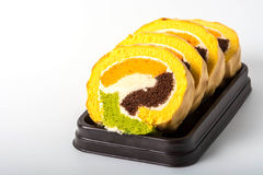 Yam roll cake on black plate Royalty Free Stock Photo
