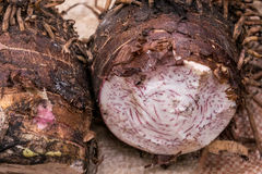 Yam sold on african market Stock Photos