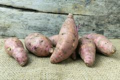Yam on wooden table. Food Royalty Free Stock Images