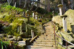 Yamadera Shrine Complex Stairs. Stairs that lead to the Yamadera shrine complex on top. Can see multiple rock carvings and statues on both sides of the stair Stock Photo