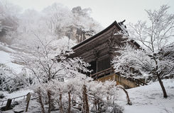 Yamadera shrine in snowfall Stock Photos
