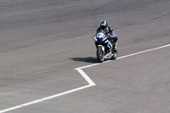 Yamaha bike speeding on circuit Stock Photo