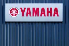 Yamaha logo på en vägg Royaltyfri Fotografi