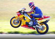 Yamaha motorbike wheelie. Valmoto Yamaha Superbike / motorbike popping a wheelie. Nick Jefferies former Isle of Mann TT competitor. Tonfanau raceway July 6th stock photography