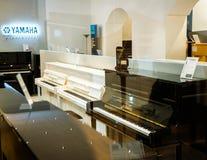Yamaha Pianoworld luxury piano store royalty free stock photos