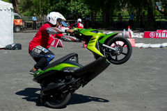 Yamaha scooter stunt drivers. Sporting event in Bali, Indonesia organised by Yamaha for presentation of a new scooter model with stunt riding competition of Stock Images