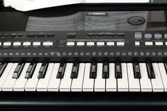 Yamaha synthesizer with musical notes close-up. Music learning concept. Georgievsk, Russia - July 22, 2018: Yamaha synthesizer with musical notes close-up. Music stock photography